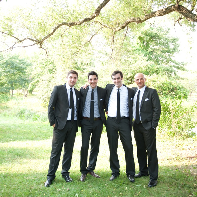 Groomsmen wore black suits from Zara with matching ties from American Apparel.