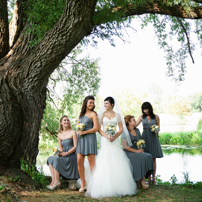 Lindsay's bridesmaids dressed in different styles of slate gray dresses.