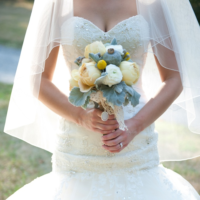 Lindsay's bridal bouquet made a statement with large muted green poppy pods.