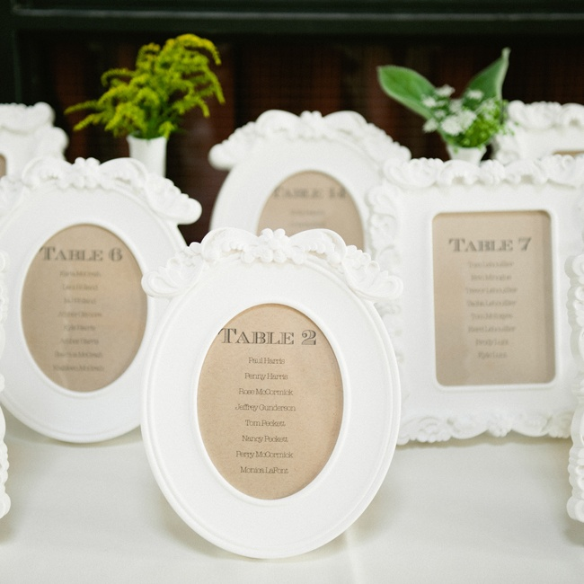 Table assignments were printed on neutral brown paper and placed in white photo frames.