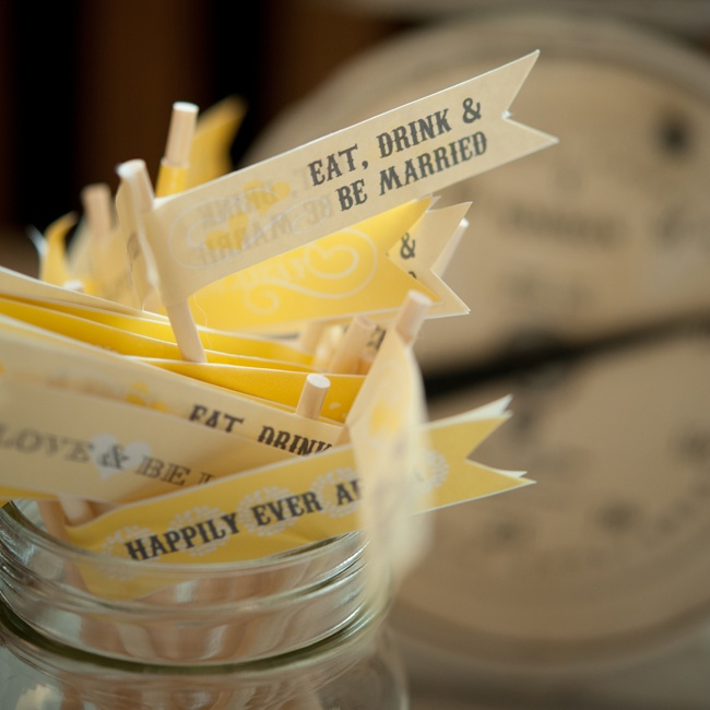 "Cocktail Stirrers with yellow flags that said, ""Eat, Drink & Be Married"" and ""Happily Ever After"" were used during cocktail hour."