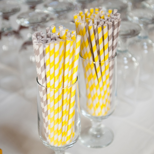Striped yellow and gray straws were on hand for cocktail hour.