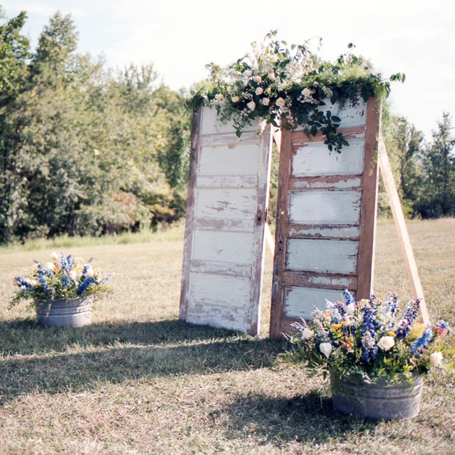 As a nod to their background in architecture, the couple constructed a rustic alter out of two repurposed doors topped with a lush floral arrangement.