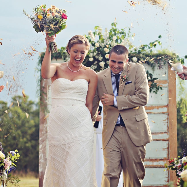 Guests showered the newlyweds with helicopter seeds as they made their way up the aisle.