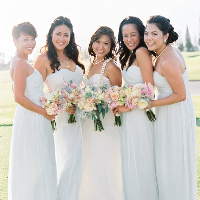 Reimi's bridesmaids donned white strapless chiffon gowns with sweetheart necklines that complemented the bride's own dress.