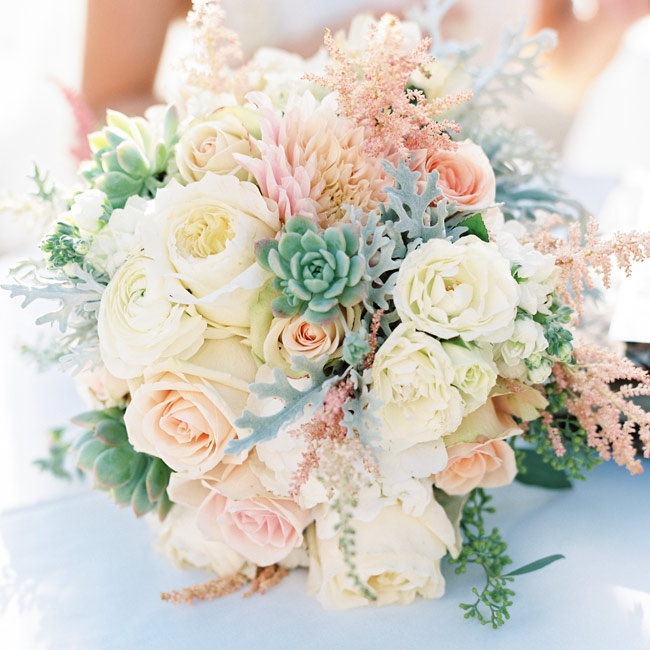 Pastel roses, peonies and dahlias were accented with dusty miller in Reimi's bouquet.