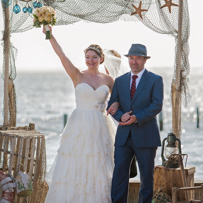 A nautical alter decorated with fish netting, sea glass and starfish completed Lindsay and Graham's seaside nuptials.