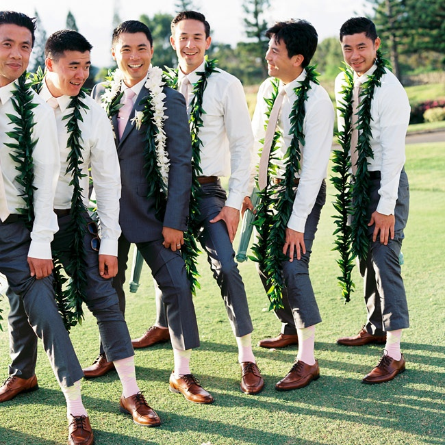 Jonathan's groomsmen mixed classic pieces with Hawaiian flair to create a casual look. Light pink ties and matching argyle socks kept with the day's color palette.