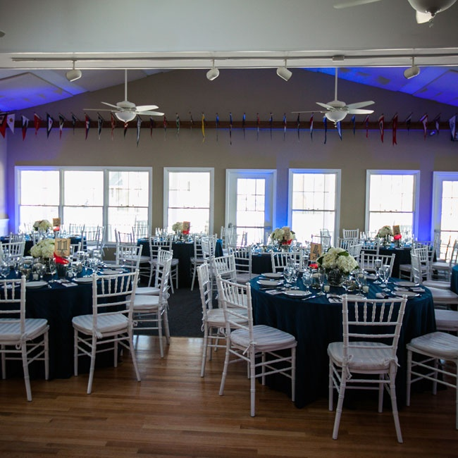 Lindsay and Graham transformed the Brant Beach Yacht Club with white chiavari chairs, navy linens and fabulous white florals.