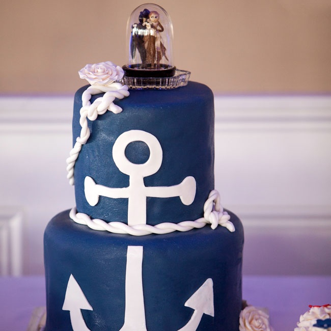 The preppy navy fondant cake took inspiration from Lindsay and Graham's nautical theme by incorporating an oversized anchor and white fondant rope detailing.