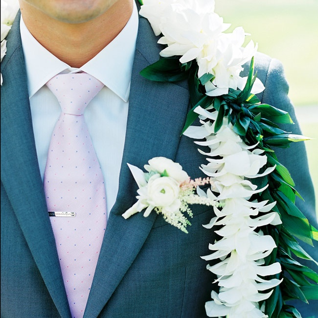 Jonathan's boutonniere made of white ranunculus popped against his navy suit. The long white lei added a tropical and traditional element to the outfit.