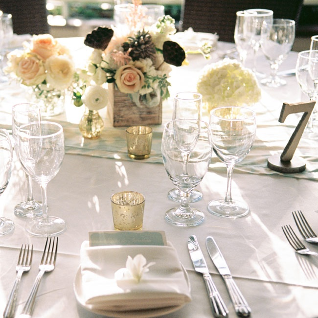 Pastel roses set in distressed wood vases and yellow accent pieces played off the Hawaiian sun creating a warm and romantic vibe.