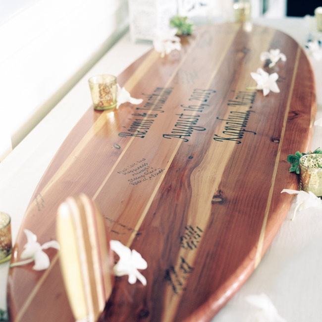 A custom wooden surfboard was a fun twist on a traditional guestbook.
