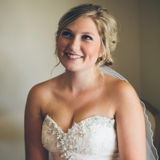 For her hair, Madison opted for romantic tousled waves and braids gathered into a low chignon paired with natural-looking makeup. A simple homemade veil added a traditional element to the look.