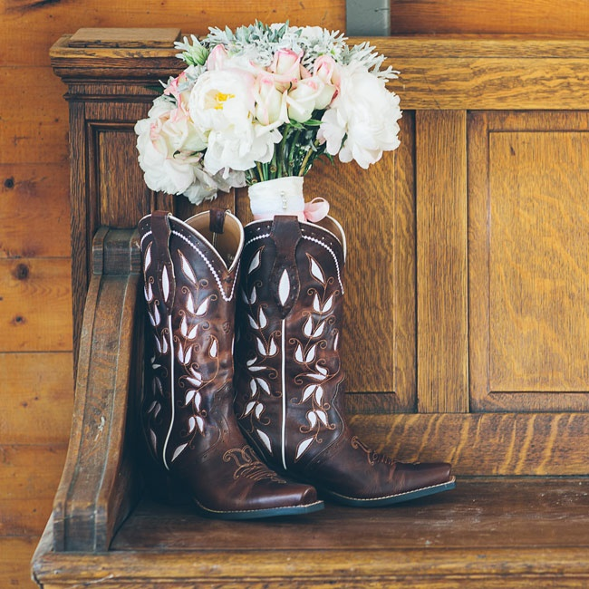 In place of traditional heels, Madison played up the wedding's ranch theme by choosing a pair of dark brown Ariat cowboy boots detailed with a dainty floral print.