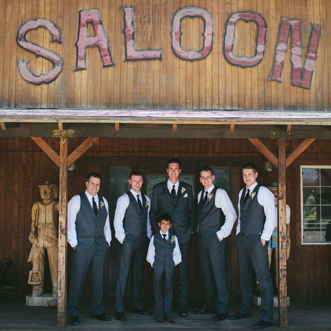 Brent's groomsmen's look was casual but elegant. They wore classic gray vests and pants paired with black ties.