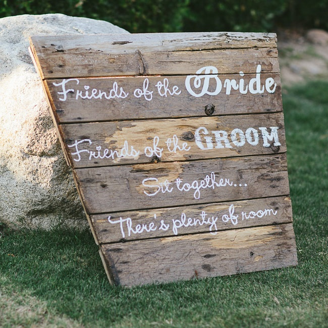 Rustic distressed wood signs leading into the ceremony encouraged Madison and Brent's guests to mix and mingle.