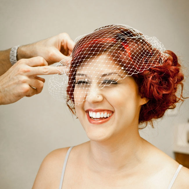 Caitlin wore three different headpieces throughout the wedding, but for the ceremony she chose a vintage birdcage veil.