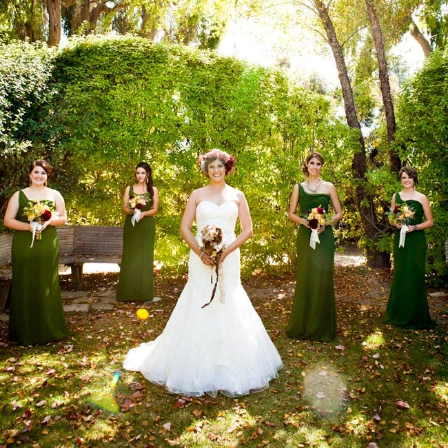 Caitlin's bridesmaids looked elegant in matching one-shoulder floor-length gowns.