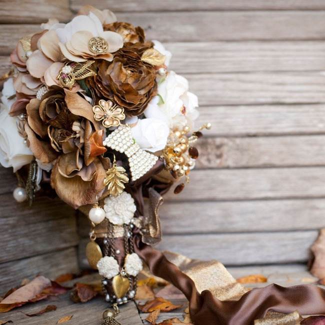 Caitlin wanted a bridal bouquet that would last forever which is why she chose a brooch bouquet for her wedding. Carefully selected golden brooches and rich brown blooms filled the bouquet.