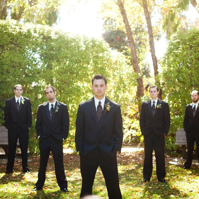 Mark and his groomsmen went for a classic style wearing black suits and dress shoes. Rich brown ties and vests kept with the day's color palette and fall motif.
