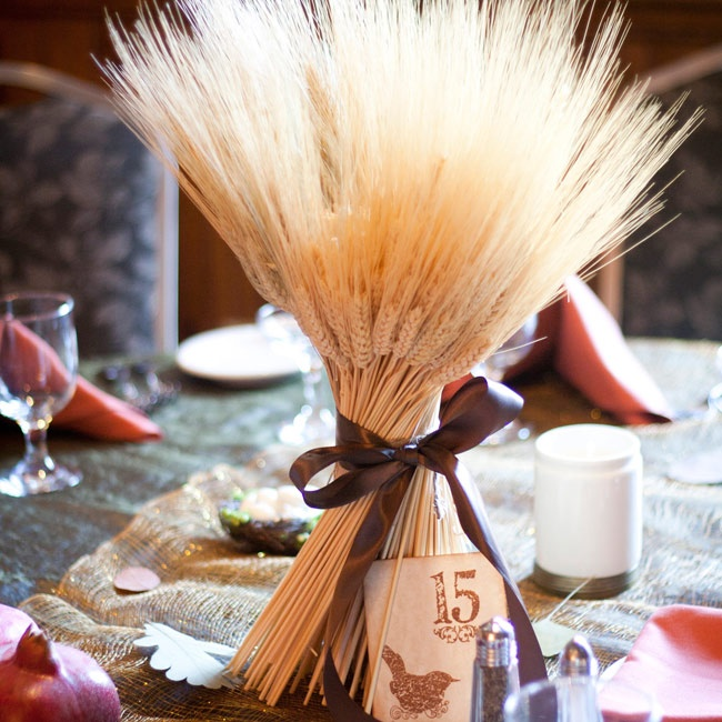Centerpieces made from wheat stalks and brown satin ribbon graced every other table alongside maple leaves, bird nests and pomegranates. Table name cards continued the rustic bird motif in honor of the bride's maternal grandmother.