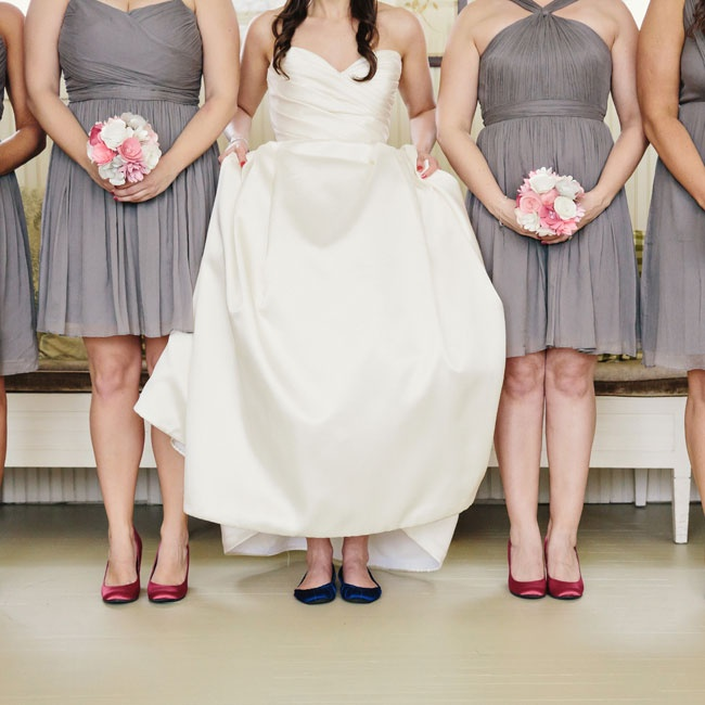 Satin flats and paper flower bouquets popped against the bridesmaids' mixed gray dresses.