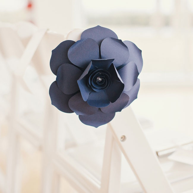 A large navy paper flower (made by the bride) popped against the sleek white ceremony setting.