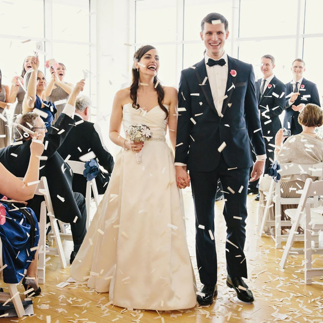 Paper confetti showered the couple and complemented the modern paper flower motif.