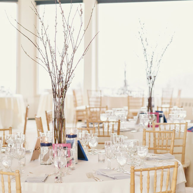 Tall pussy willow centerpieces added to the reception's minimal winter vibe.