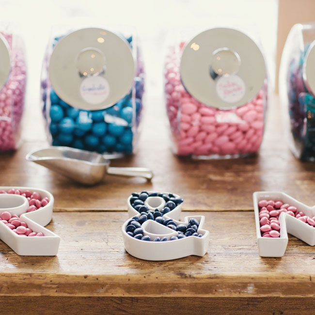 The couple incorporated their initials and wedding colors into the candy bar with modern monogram bowls.