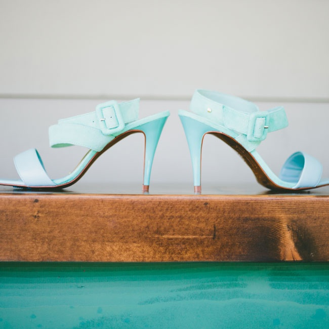 "For her ""something blue"" Megan wore these cute strappy pale blue heels by Ted Baker."