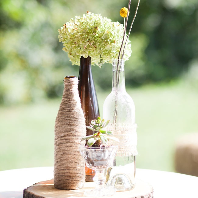 During cocktail hour, tables were topped with hydrangeas and billy balls in antique bottles. Twine and lace added a rustic touch to the decor.