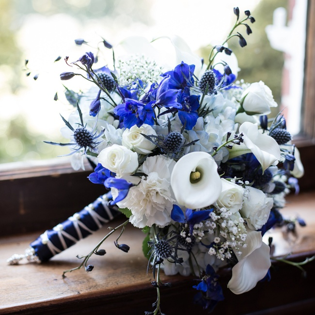 Abby's bouquet was inspired by her favorite football team, the New York Giants. White calla lillies and roses mixed with blue sea holly for a textured affect.