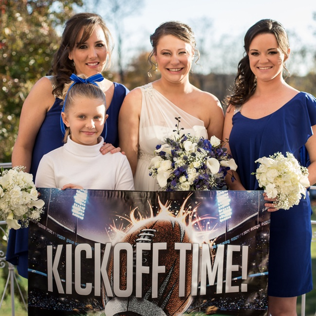 "Abby's bridesmaids sported her favorite team's colors and her flower girl even looked like a cheerleader. The bride went down the aisle with a sign that said, ""Kickoff Time!"""