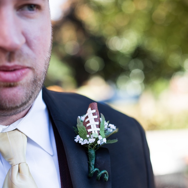 Groomsmen wore floral boutonnieres accented with a miniature football piece.