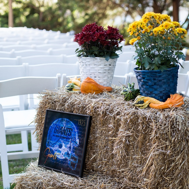 Haystacks and squash made the perfect fall backdrop for the ceremony while the Giants helmet kept with Abby's football theme.