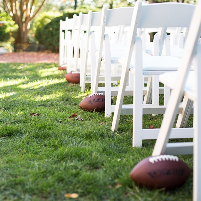 Actual leather footballs lined the ceremony aisle.