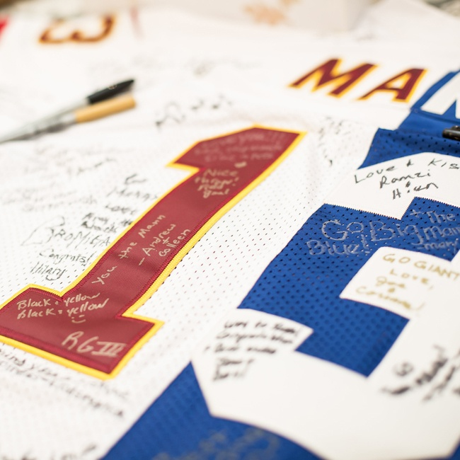 The bride and groom had a custom NFL jersey made out of their two favorite teams' colors that guests signed as a guest book.