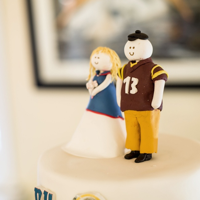 Abby and Greg's cake topper was custom made to commemorate their favorite sports teams.