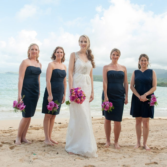 Bridesmaids wore strapless navy dresses and went barefoot for the ceremony.