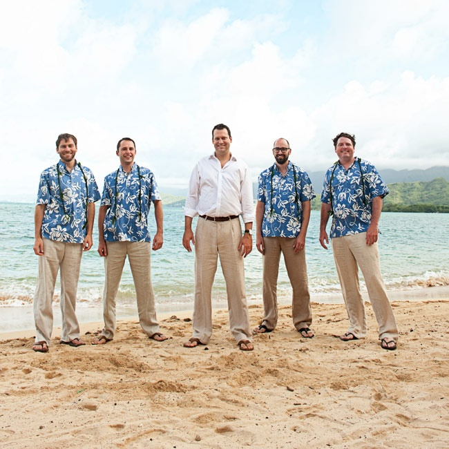 Groomsmen kept it casual in blue Hawaiian shirts with light tan slacks and flip-flops.