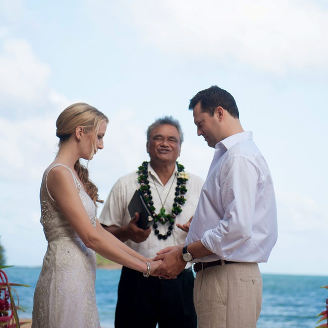 The couple's ceremony was celebrated on the beach of Secret Island at Kualoa Ranch in Hawaii.