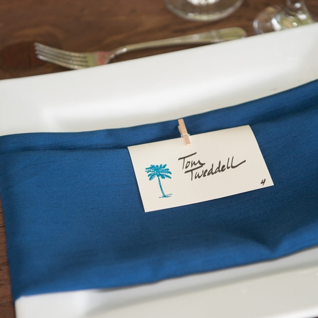 Each place setting featured a navy napkin with an island theme place card.