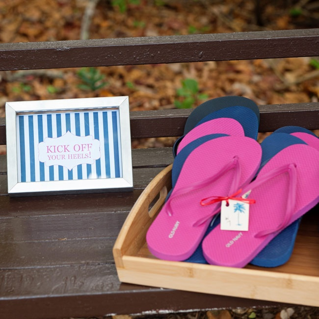 "Guests were encouraged to ""kick off their heels"" with these flip-flop wedding favors."