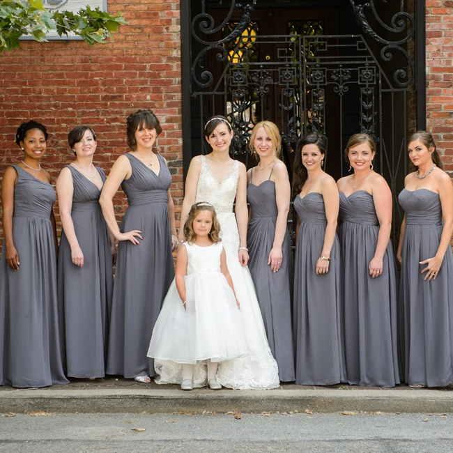 Sarah's bridesmaids wore long gray gowns with draped bodices with sweetheart, one-shoulder and v-neck necklines.