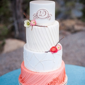 Draped White and Coral Cake
