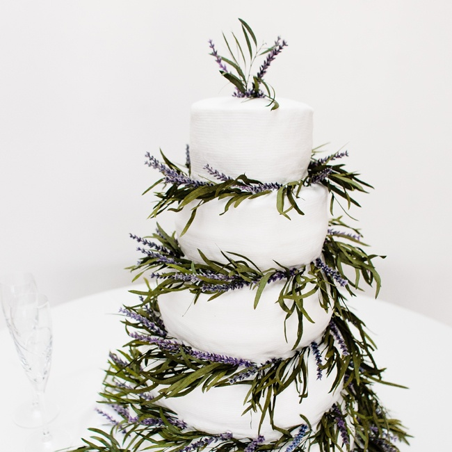 Wispy lavender blooms adorned the couple's traditional white cake for a touch of Provençal elegance.