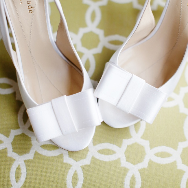 Elise wore this pair of white Kate Spade bridal heels down the aisle.