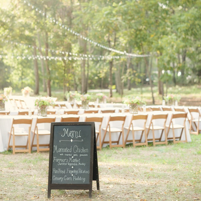 Reception decor included bistro lighting, long farm tables and a handwritten chalkboard menu.